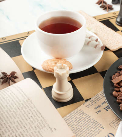 A cup of tea and a chess rook Foto de archivo
