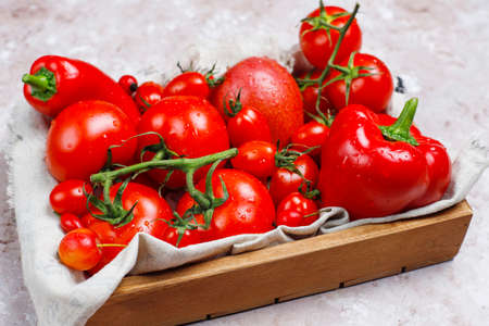 Fresh red vegetables on light concrete background,top view Stock Photo