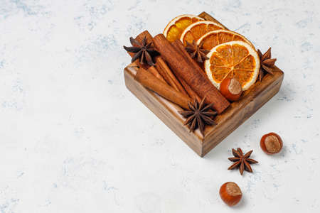 Mulled wine spices in wooden box on light background 免版税图像