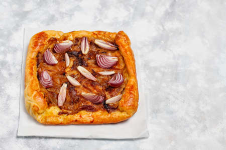 French style onion pie galette with puff pastry and various onions shallot,red,white,yellow onions,top view Stock Photo