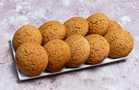 American style peanut butter cookies on light concrete background.
