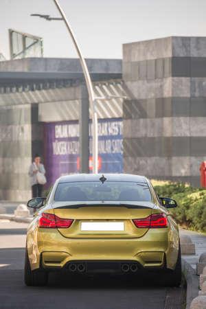 Golden sport sedan car back view Фото со стока