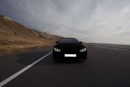 Black velvet sport sedan on the road in a cloudy weather