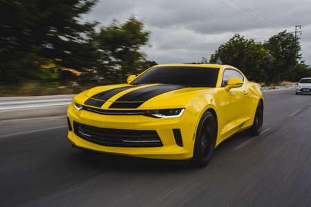 Yellow sport car with black tuning on it Banco de Imagens