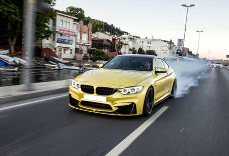 Golden luxury sport sedan, front view
