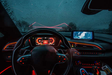 Direction wheel and navigation system of a car, red lights interior