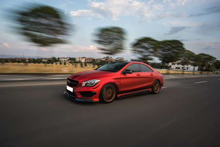 Red sport car high speed drive on the road Stockfoto