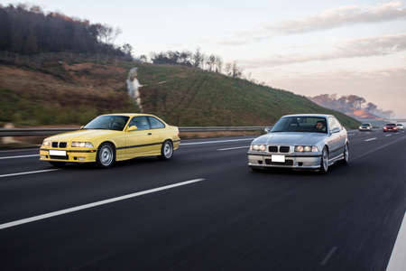 Yellow and silver sport cars race