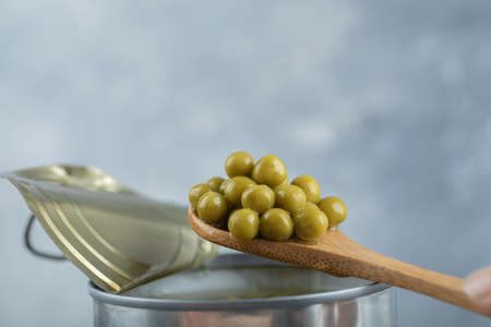 Taking olives from tin with spoon