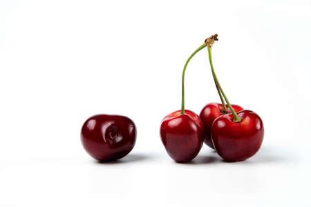 A bunch of red cherries on white background Standard-Bild