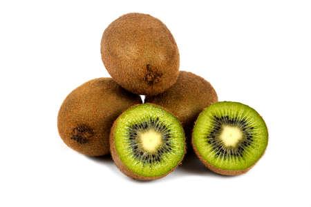 Whole kiwi fruits and half kiwi fruits on a white background