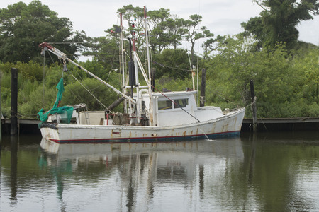 A Shrimp Boat is being prepared to go out shrimp fishing
