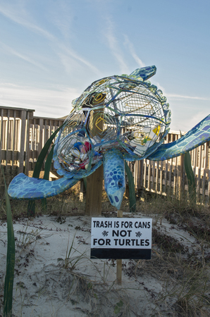 A large Sea Turtle statue reminds tourists of the dangers of plastic bottles in the Ocean.