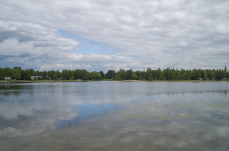 Clouds reflected off Big Nellie Lake Ontario Canada Stockfoto