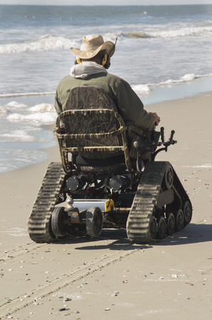 A Track powered wheele chair propels a person along the sands of Myrtle Beach ,South Carolina