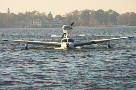 A Seaplane heads for shore after landing at a Festival in Bridgeton,North Carolina