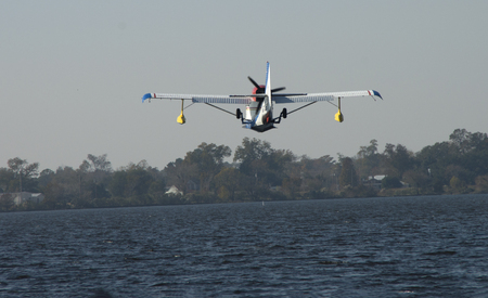 A Seaplane approaches the water for a landing at a festival in Bridgeton ,North Carolina