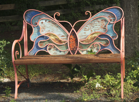 A Bench in the shape of a butterfly sits in a campground in Va.Beach ,Va.