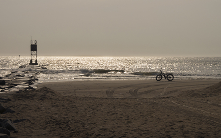 A Beach Bicycle is ready for a morning ride along the Atlantic Ocean near the Delaware Seashore State Park