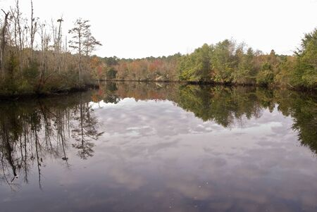 The sky is reflected on the Trent River in New Bern North Carolina