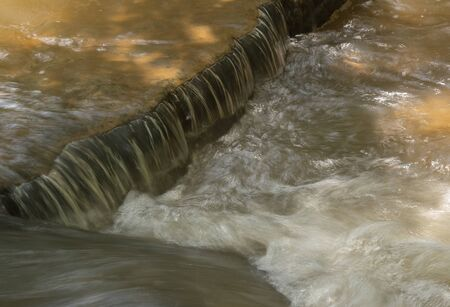 An Eddy forms in the river that flows beneath the Shanks Town Road waterfall near Winston_Salem,North Carolina