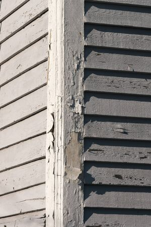 Paint peels away from the side of an old house in New Bern ,North Carolina Reklamní fotografie