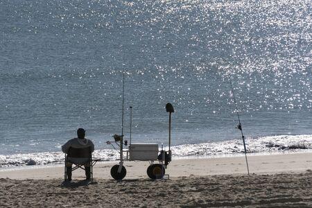 A surf fisherman waits for a bite along the coast of Emerald Isle ,North Carolina Reklamní fotografie