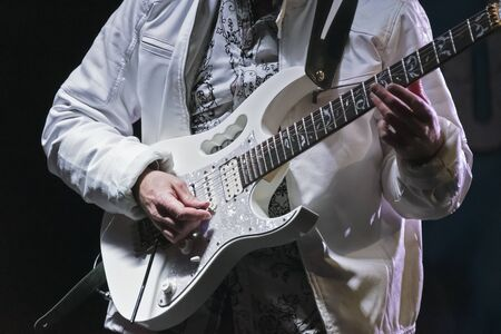 A band member at a First Night Celebration in New Bern ,North Carolina demnstrates his skill playing an instrumental solo on the electric guitar. Reklamní fotografie