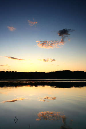A peaceful sunset over a beautiful blue sky and still water of Kama River, Russian Federation