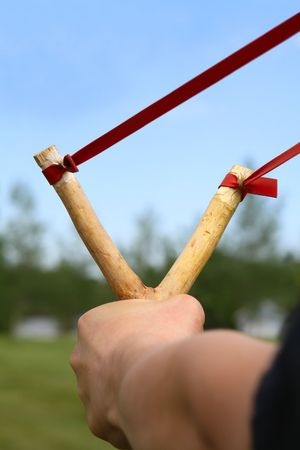 Close-up of a slingshot aimed and ready to shoot.