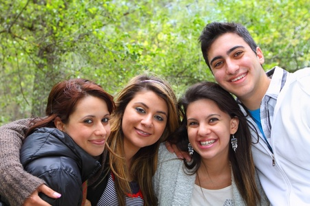Three girls and one guy smiling together Stock Photo - 9641783
