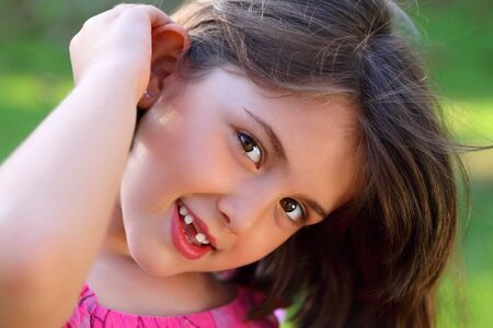 Close up of adorable little girl looking