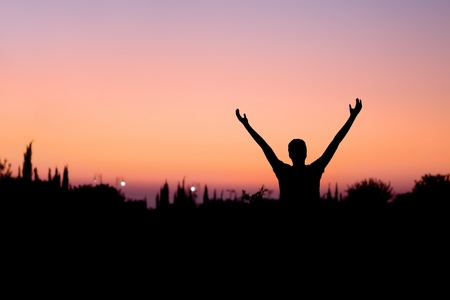 silhouette of a man with arms raised at night Stock Photo - 10389791