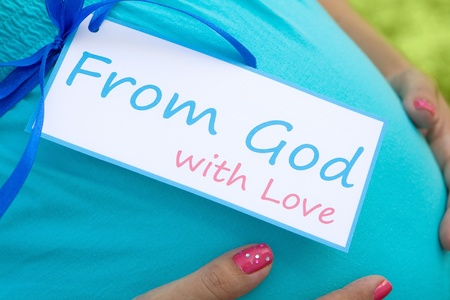 gods love: Close-up of expecting moms tummy with card From God with Love