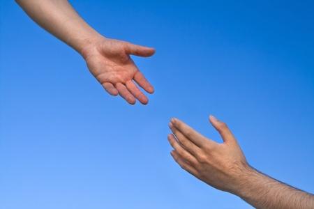 pardon: Mains tendues vers l'autre Banque d'images