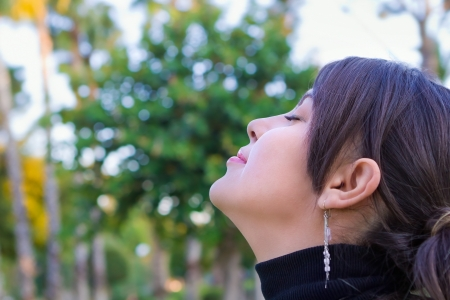 Young girl smiling outdoors Stock Photo - 14994372