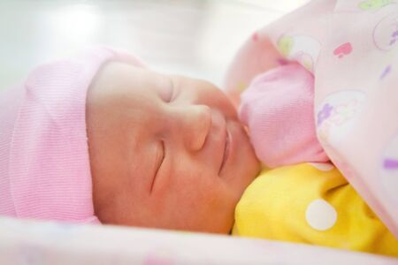 Smiling newborn girl sleeping close-up Stock Photo - 16143222