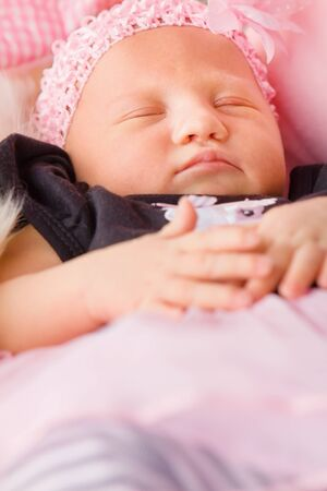 Newborn girl sleeping in blankets Stock Photo - 16143224