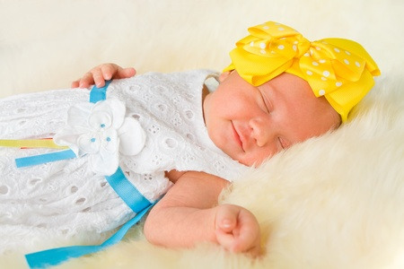 Newborn girl sleeping on fluffy carpet Stock Photo - 16143228