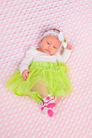 Newborn baby laying on pink blanket Stock Photo - 16411128
