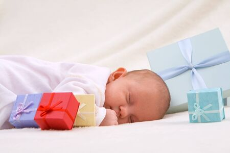 Colorful gift boxes with sleeping baby Stock Photo - 16411125