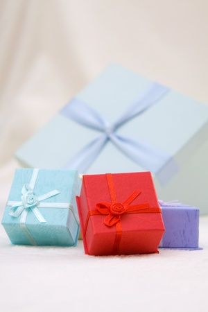 Mini colorful gift boxes on soft background