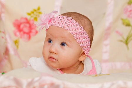Cute Baby girl on flower blanket photo