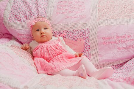 Baby girl on pink blanket with Bible verses Stock Photo - 17966998