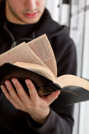 Young man reading the Bible Stock Photo - 18600524