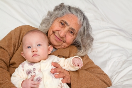 legacy: Great Grandma holding her great granddaughter