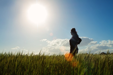 Girl standing in a sunny field of grass Stock Photo - 19838207