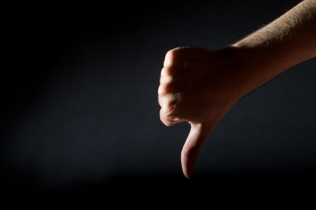Thumbs down on black background Stock Photo - 20005277
