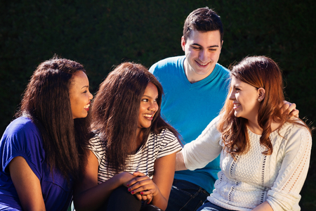 Young adult interracial group of friends talking and laughing