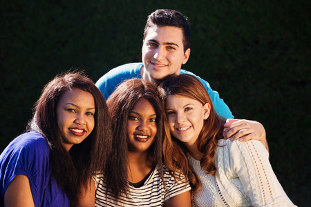 mixed race ethnicity: Young adult interracial group of friends  close up